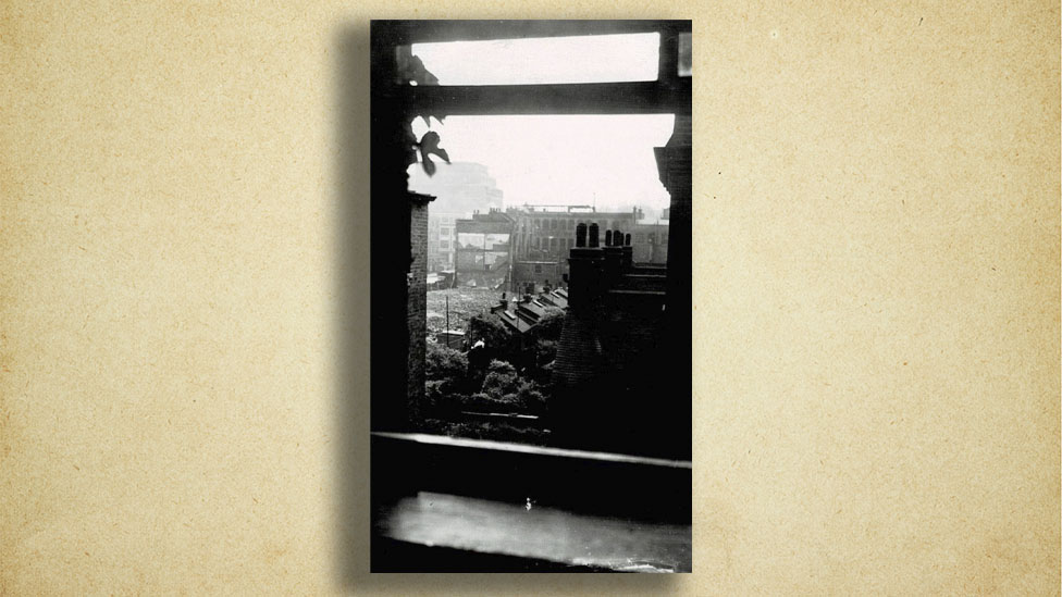 bomb damage seen from window