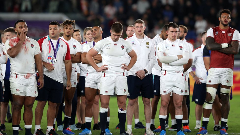 England captain Owen Farrell (centre) stand dejected with his team-mates after the 2019 Rugby World Cup final match at Yokohama Stadium.