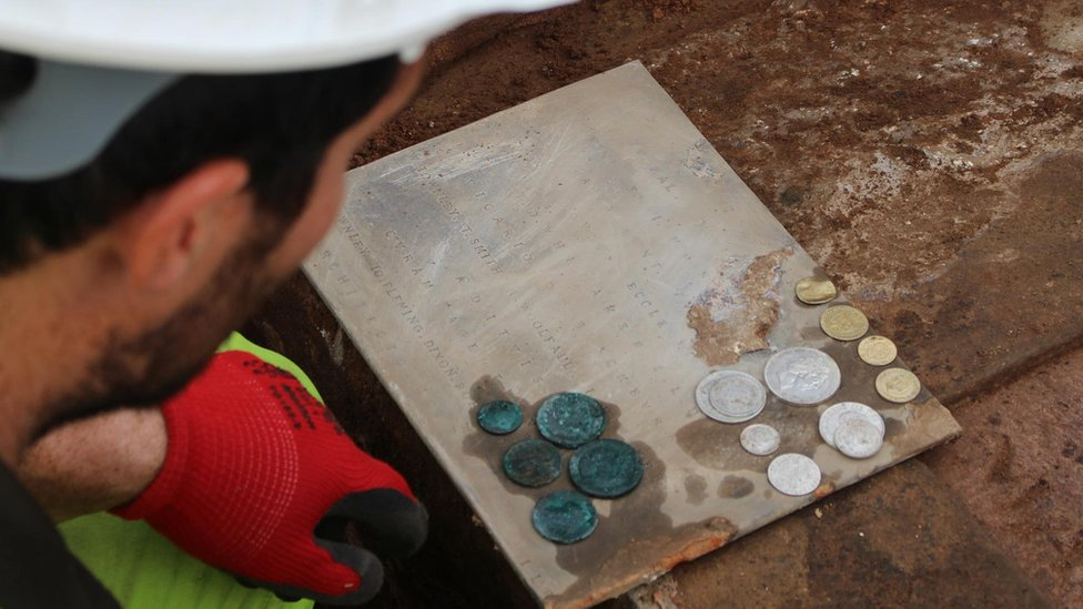 archaeologist with coins