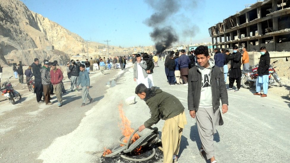 People burn tyres and block a motorway during a protest after a number of Shia minority people were killed by unknown gunmen in the Mach area on the outskirts of Quetta, Balochistan province, Pakistan, on 3 January 2021