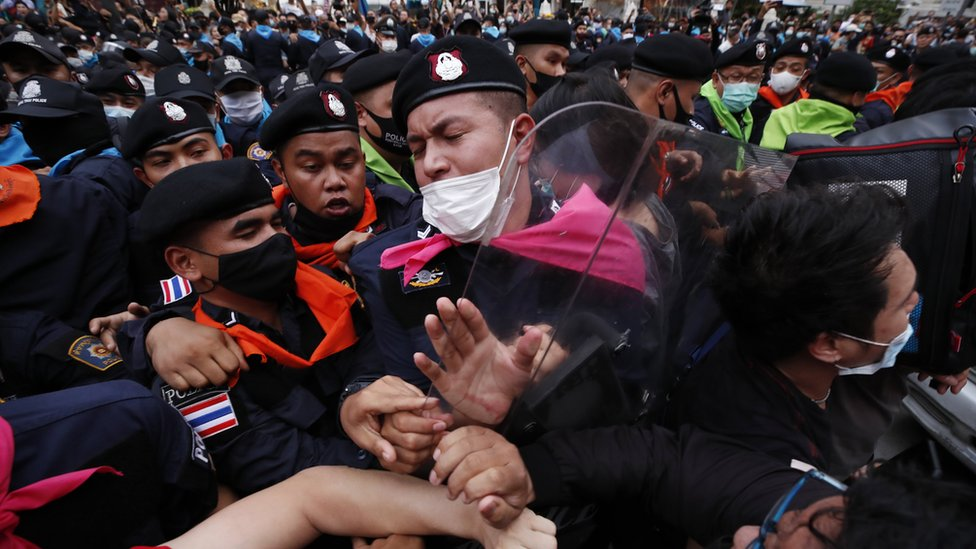 Pro-democracy protester and police officers clash during rally against the state of emergency at Ratchaprasong district in Bangkok, Thailand, 15 October 2020.