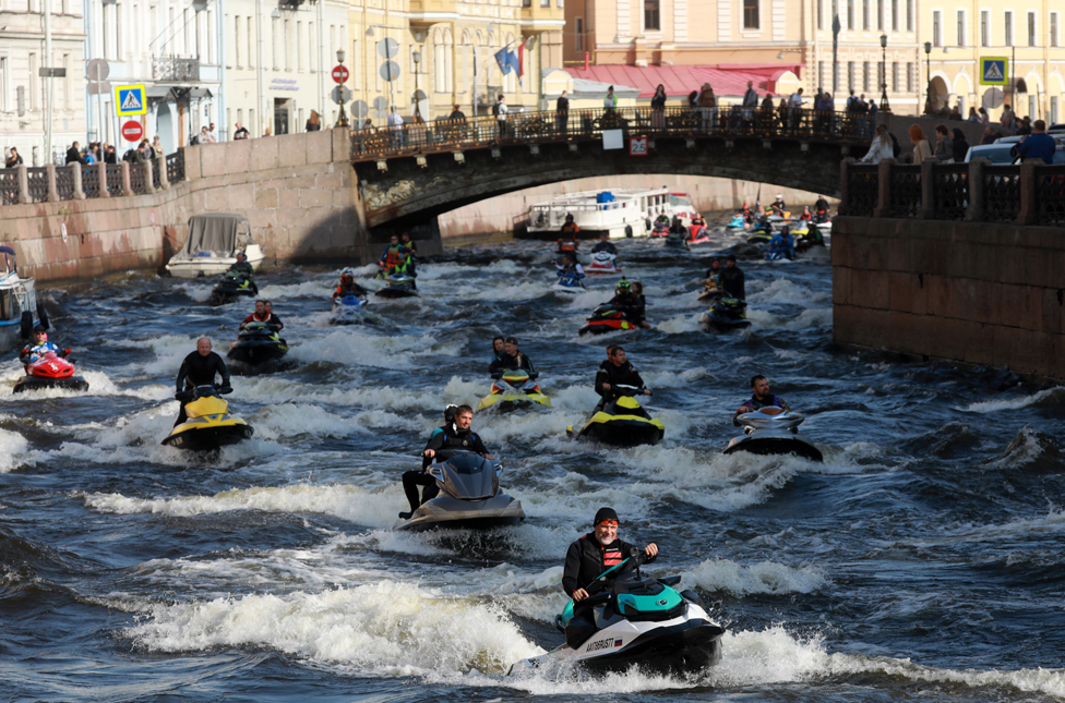 Jet skiers race along the Winter Canal in St Petersburg, Russia