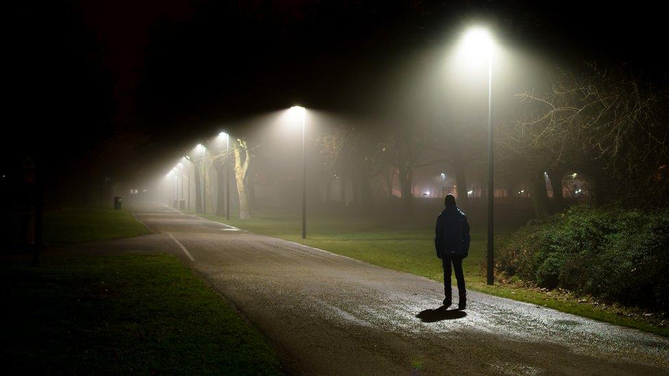 Man walking on dark night
