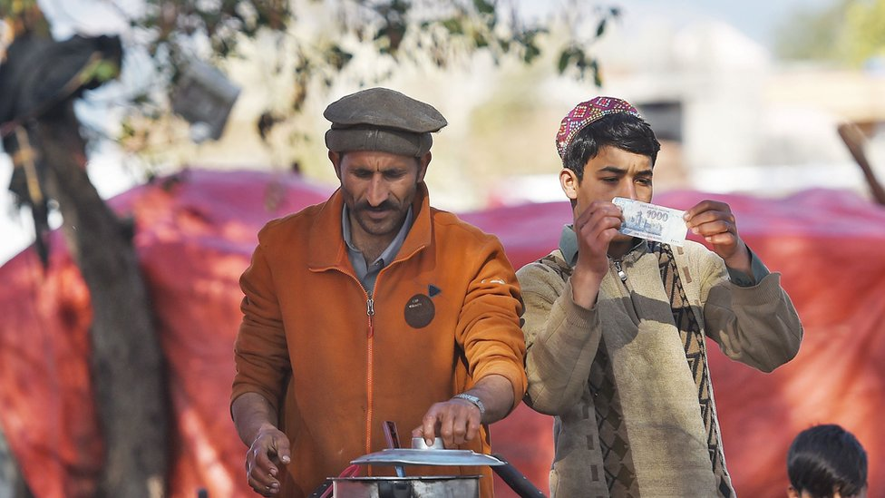 Men cook tea at a roadside stall in Pakistan