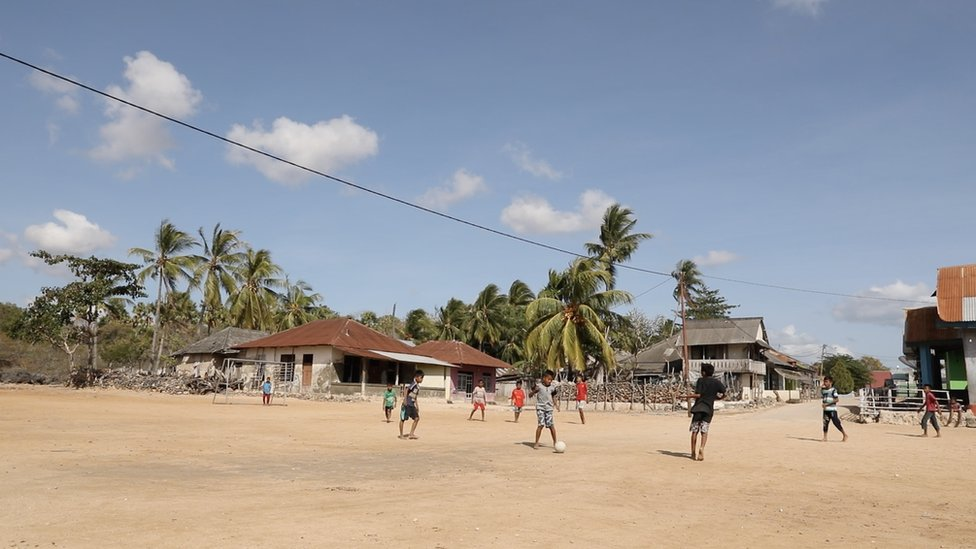 Boys playing football in Abdul's town