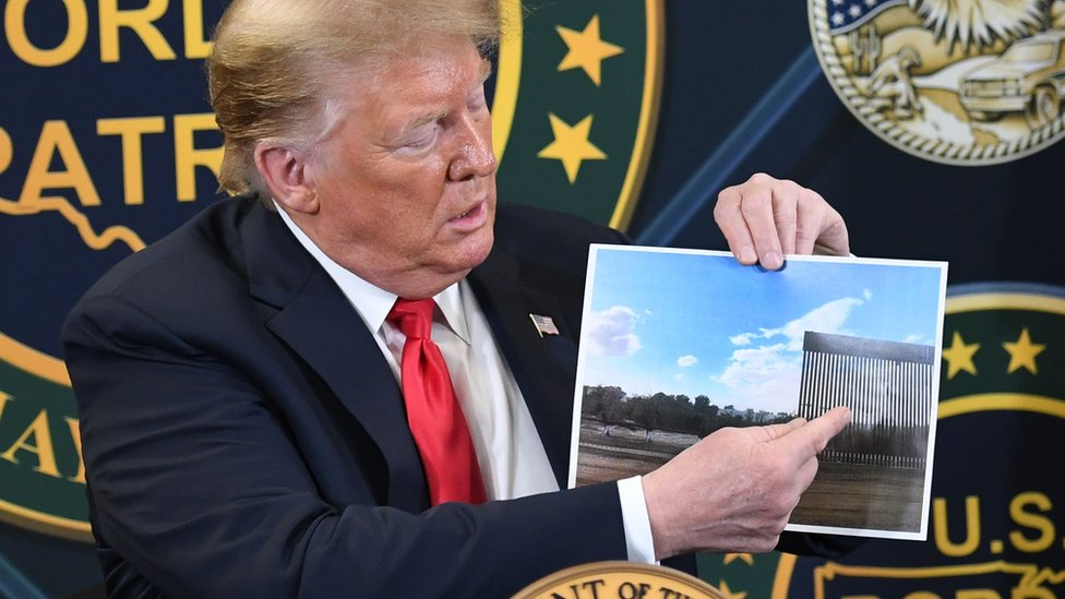 Trump and an image of the bollard barrier