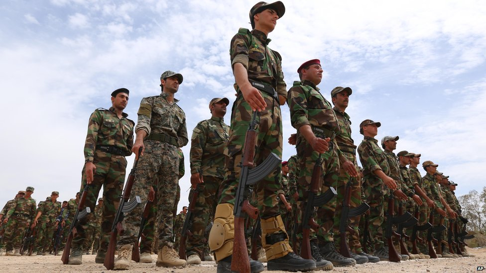 Sunni tribal volunteers stand in formation during their graduation ceremony in the town of Amiriyat al-Falluja on 8 May, 2015.