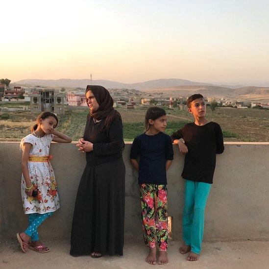 Bahar Dawood and her three children