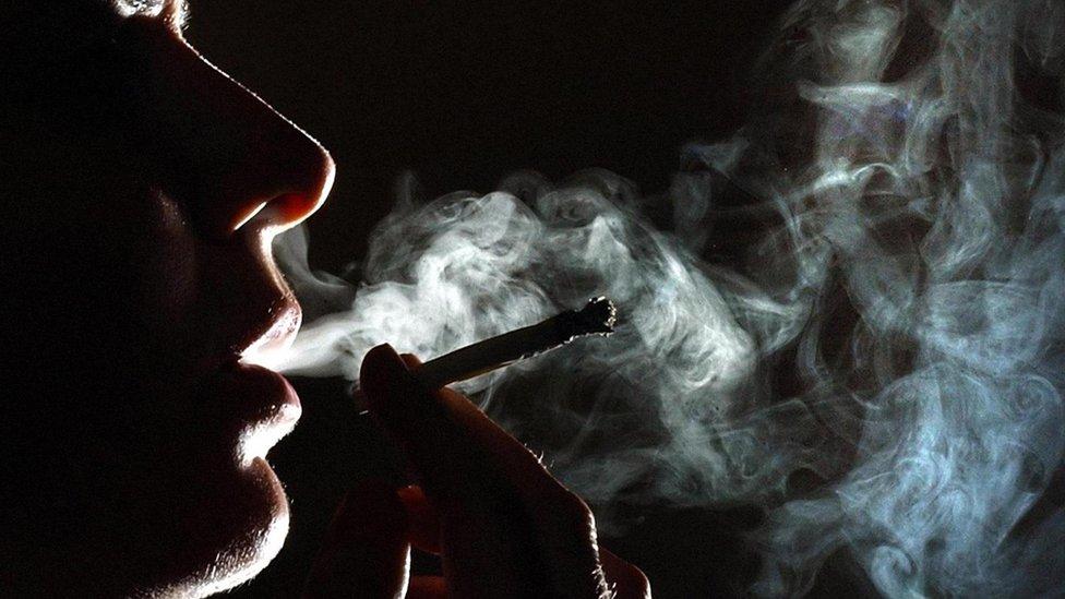 Woman smokes joint
