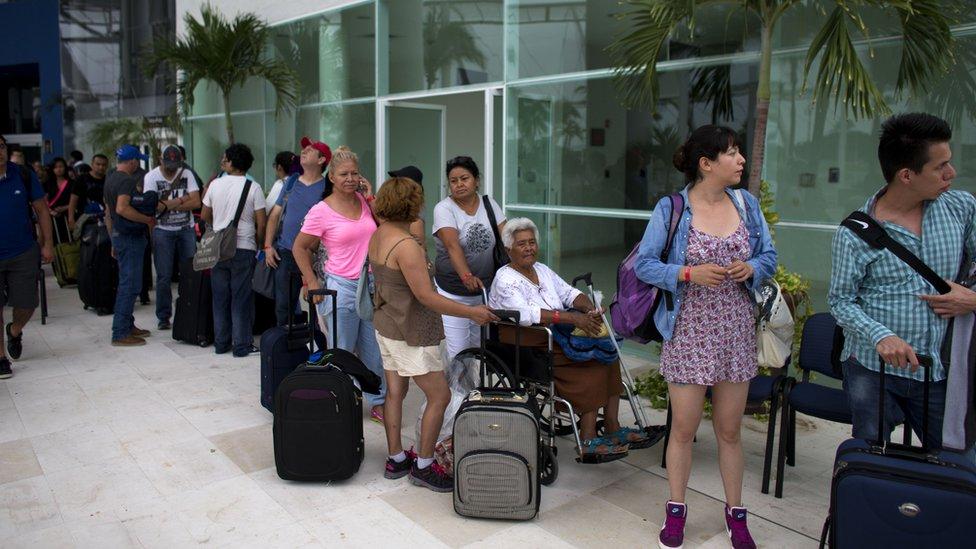 People queue for buses in Puerto Vallarta - 23 October