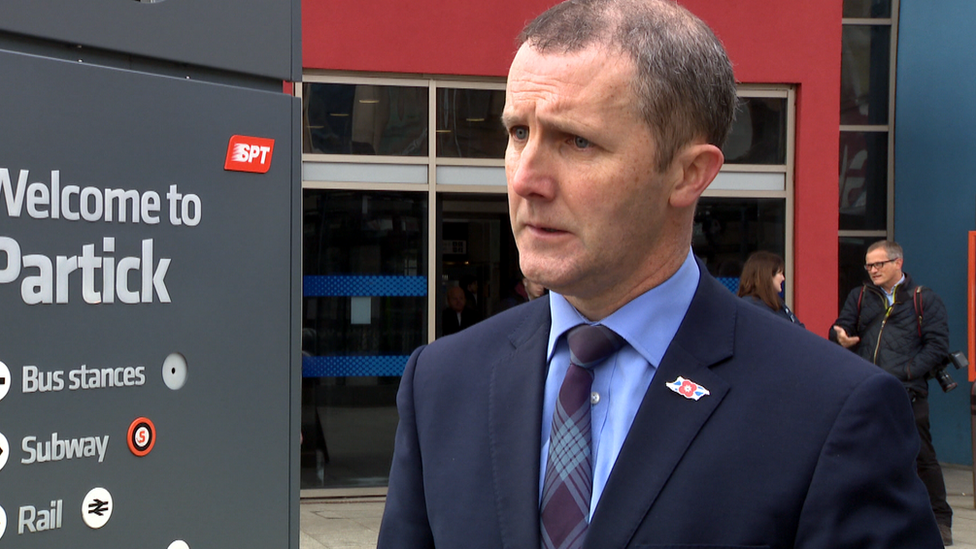 Michael Matheson being interviewed outside Partick subway station