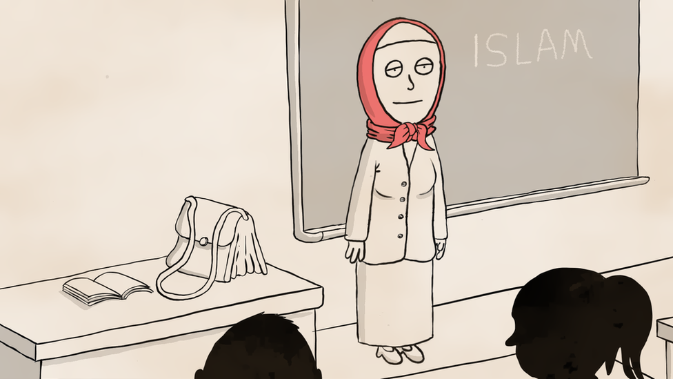 A teacher in class wearing a headscarf