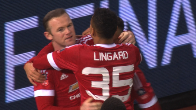Manchester United's Wayne Rooney scores injury-time penalty