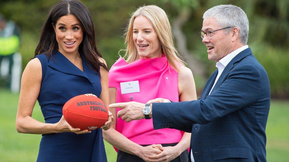 Meghan with an AFL ball
