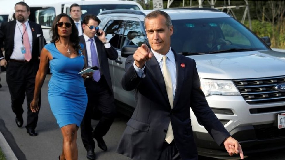 Corey Lewandowski (C) says hello to reporters as he and White House advisors Sebastian Gorka (from L), Omarosa Manigault, White House Staff Secretary Rob Porter and Communications Director Anthony Scaramucci attend an event in Ohio in 2017
