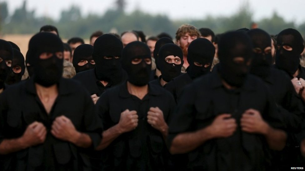 Rebel fighters take part in a military display as part of a graduation ceremony at a camp in eastern al-Ghouta, near Damascus, Syria