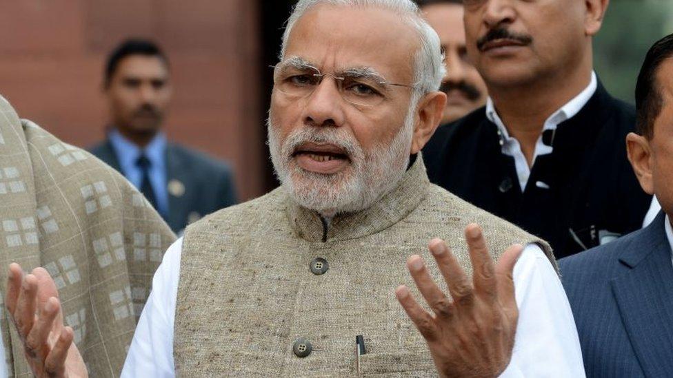 Indian Prime Minister Narendra Modi addresses media representatives after arriving for the winter session of Parliament in New Delhi on November 26, 2015