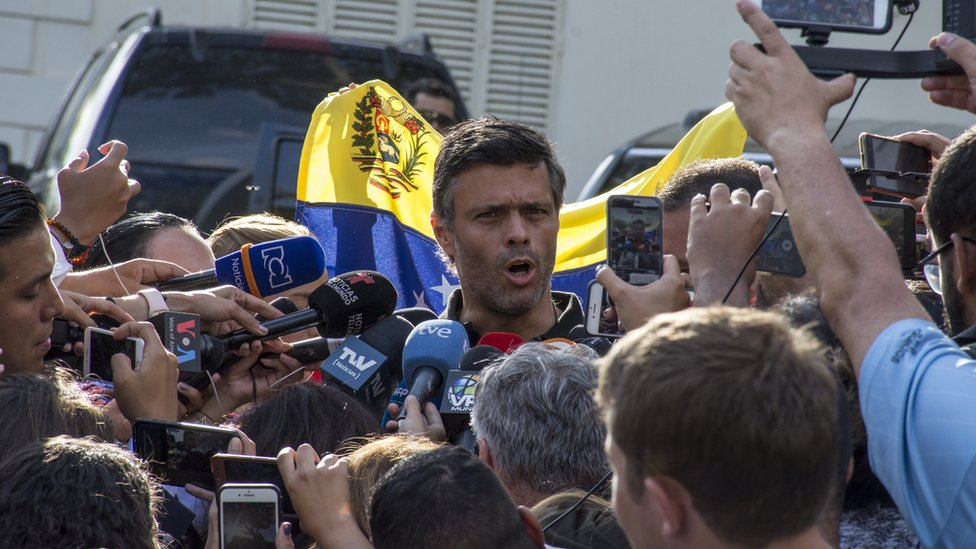 Opposition figure Leopoldo López speaking to reporters from the Spanish embassy in Caracas