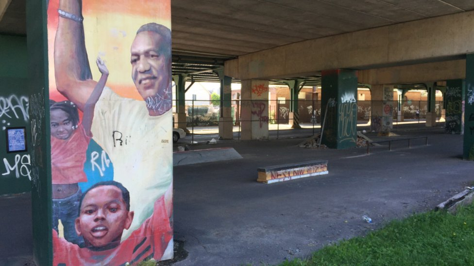 A faded mural of Bill Cosby still stands near the Richard Allen homes in North Philadelphia.