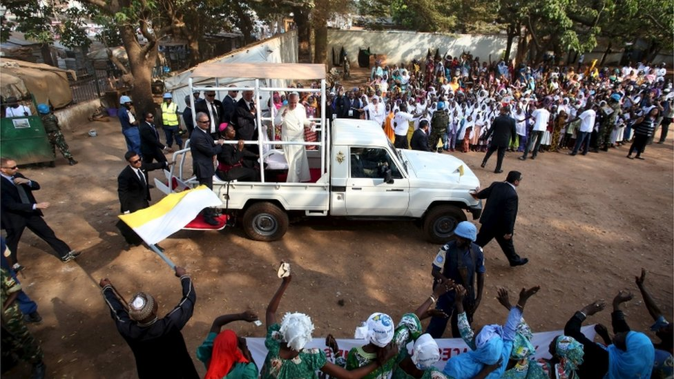 Pope Francis greets people as he arrives at the central mosque in the mostly Muslim PK5 neighbourhood of the capital Bangui, Central African Republic