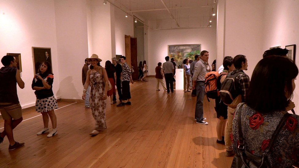 visitors in an art gallery