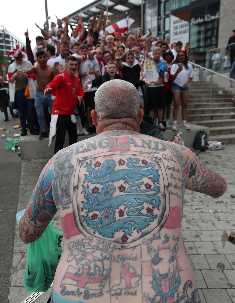 A fan is seen with England tattoos on Wembley Way outside Wembley Stadium, on 11 July 2021
