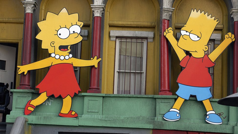Lisa Simpson and Bart Simpson cut-outs on display at 'The Simpsons' 350th episode block party on the New York street of Fox Pico Lot on April 25, 2005 in Los Angeles, California.