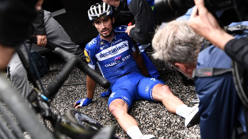Julian Alaphilippe reacts after crossing the finish line