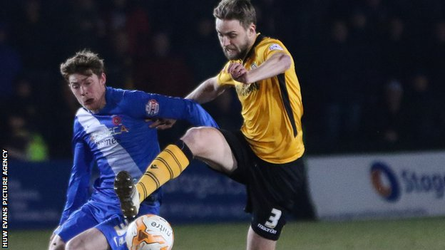 Newport County's Mark Byrne and Jake Carroll of Hartlepool compete for the ball