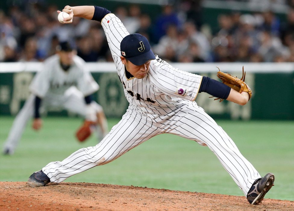 Japan's closer Kazuhisa Makita pitches against Israel during the ninth inning of their second round game of the World Baseball Classic at Tokyo Dome in Tokyo. 15 March 2017.