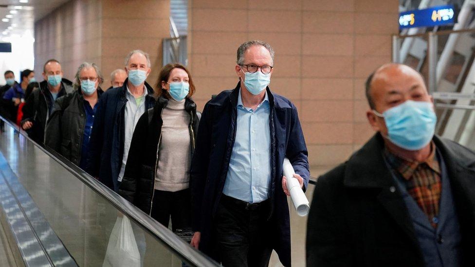 Members of the WHO team arrive in Shanghai (10 Feb)