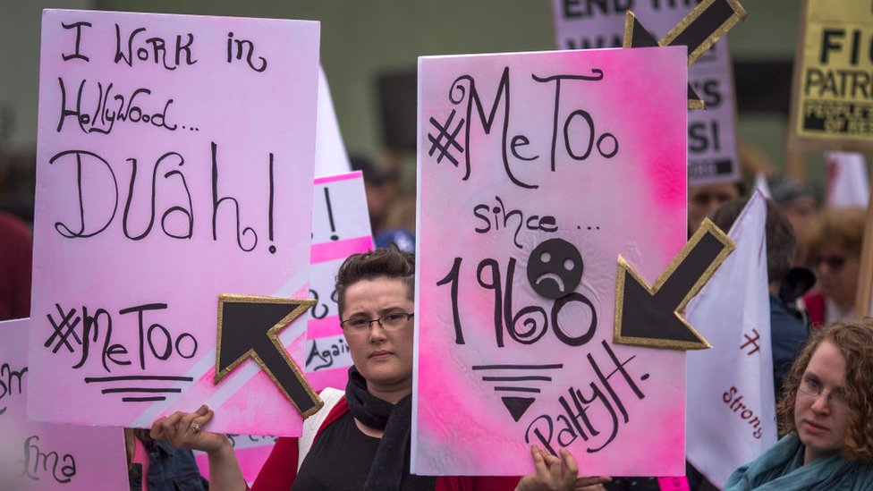 Demonstrators participate in the #MeToo Survivors' March