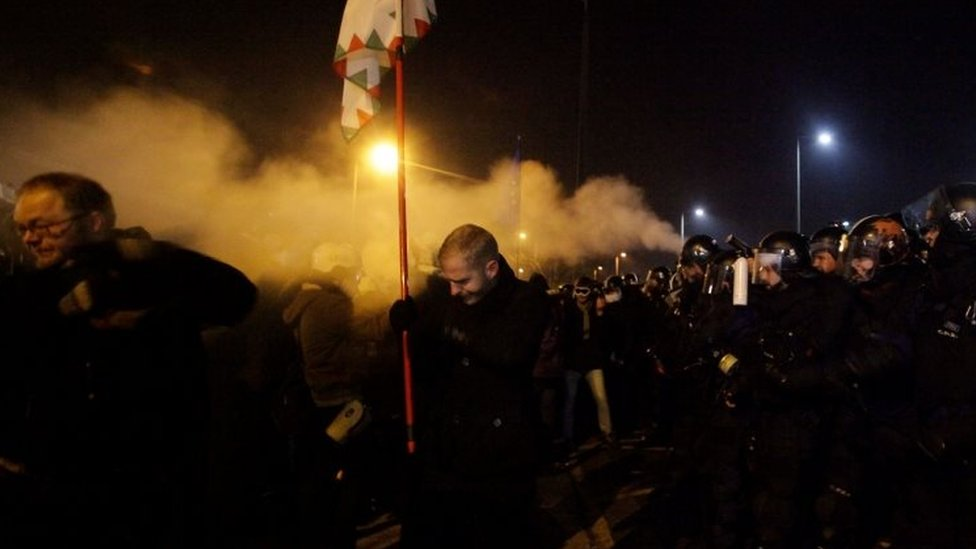 Police fire tear gas to disperse protesters outside the state TV headquarters in Budapest. Photo: 16 December 2018