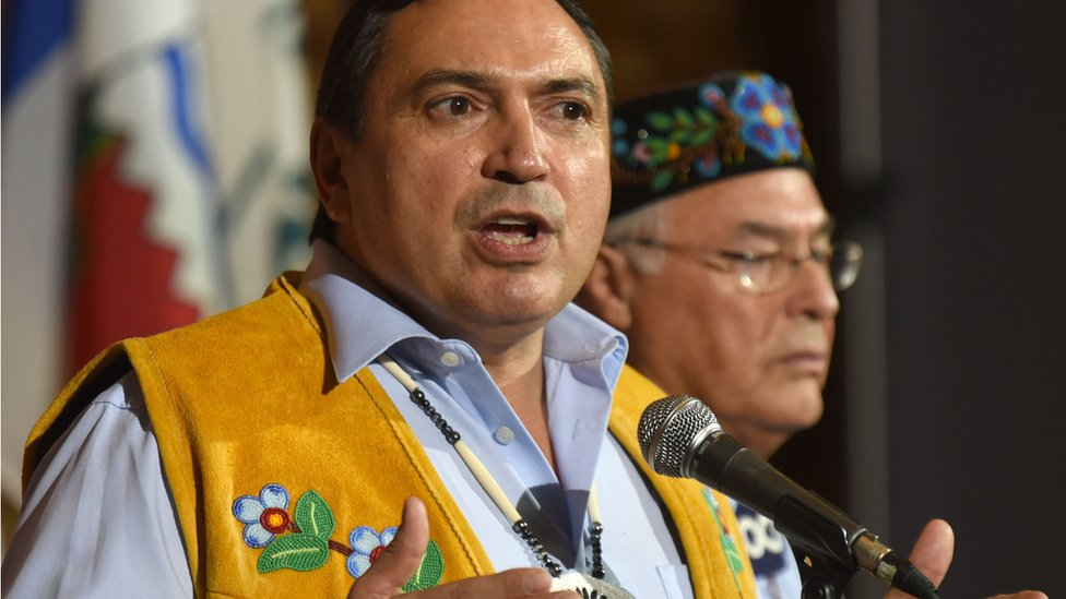 Assembly of First Nations, National Chief Perry Bellegarde, talks to media as Metis National Council President Clement Chartier listens, after the opening of the First Ministers Meeting in Vancouver on March 2, 2016