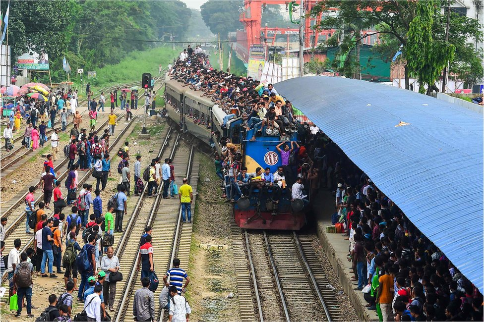Bangladeshis cram onto a train as they travel back home to be with their families ahead of the Muslim festival of Eid al-Fitr, in Dhaka on June 14, 2018
