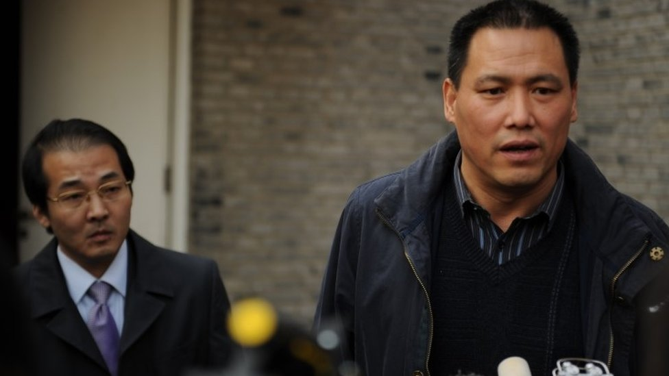 Pu Zhiqiang (R), the civil rights lawyer for Chinese artist Ai Weiwei, talks to the media at the artists studio in Beijing on November 14, 2011