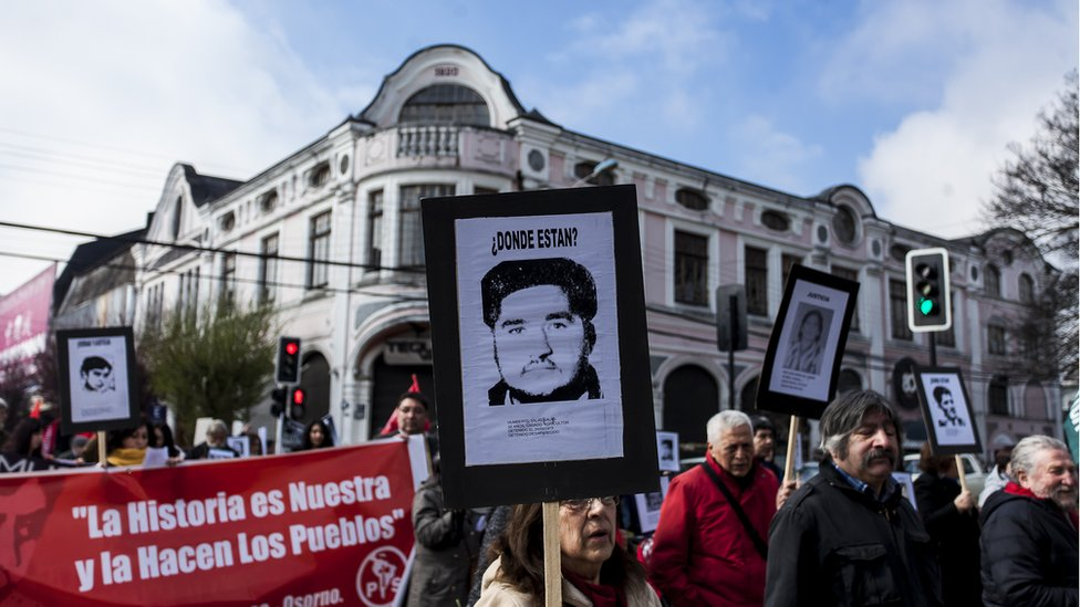 Relatives of disappeared and executed political prisoners commemorate the 45th anniversary of the coup against Salvador Allende in Osorno, Chile. 11 September 2018