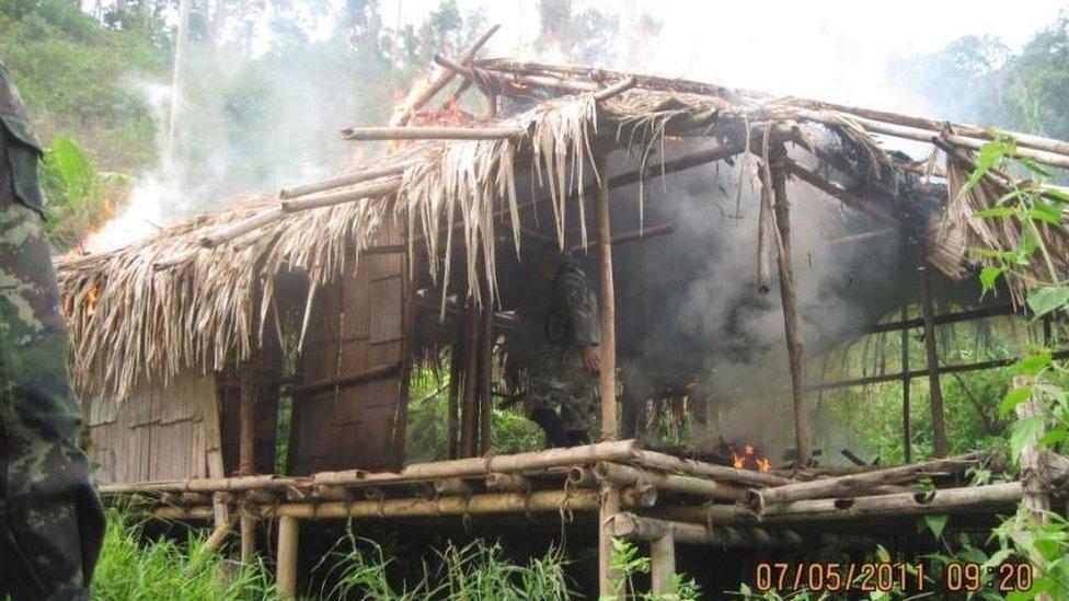A hut begins to burn
