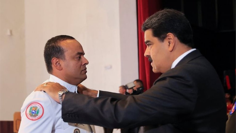 Venezuela's President Nicolas Maduro changes the epaulette of a soldier during a promotion ceremony in Caracas, Venezuela July 2, 2018.
