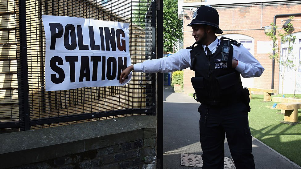 A policeman at a polling station