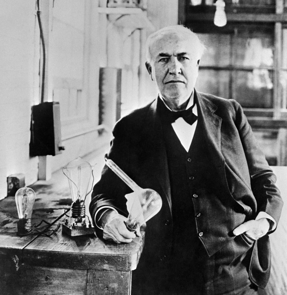 Thomas Edison holding his light bulb in the 1920s