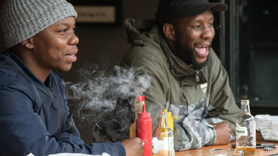 Men drinking and smoking in South Africa - August 2020