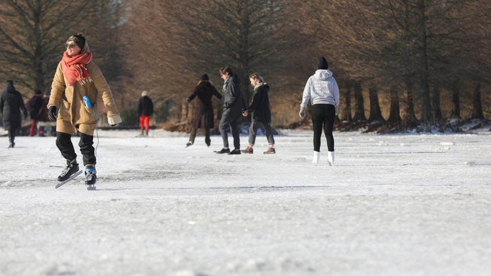 People ice skate during a cold wave across the country, in Amsterdam, Netherlands February 12, 2021.