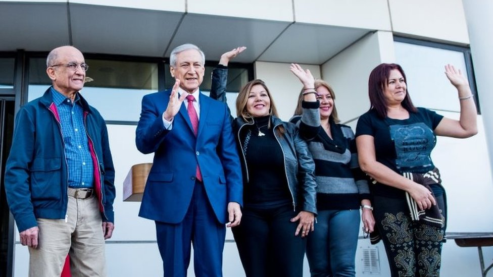 "Chile""s Foreign Minister Heraldo Munoz (2nd L) wave to the media next to Venezuela""s Supreme Court justices Jose Nunez (L), Elenis Rodriguez (3rd L), Zuleima Gonzalez (2nd R) and Beatriz Ruiz after they left the country and arrived to Chile for asylum, in Santiago, Chile October 19, 2017."