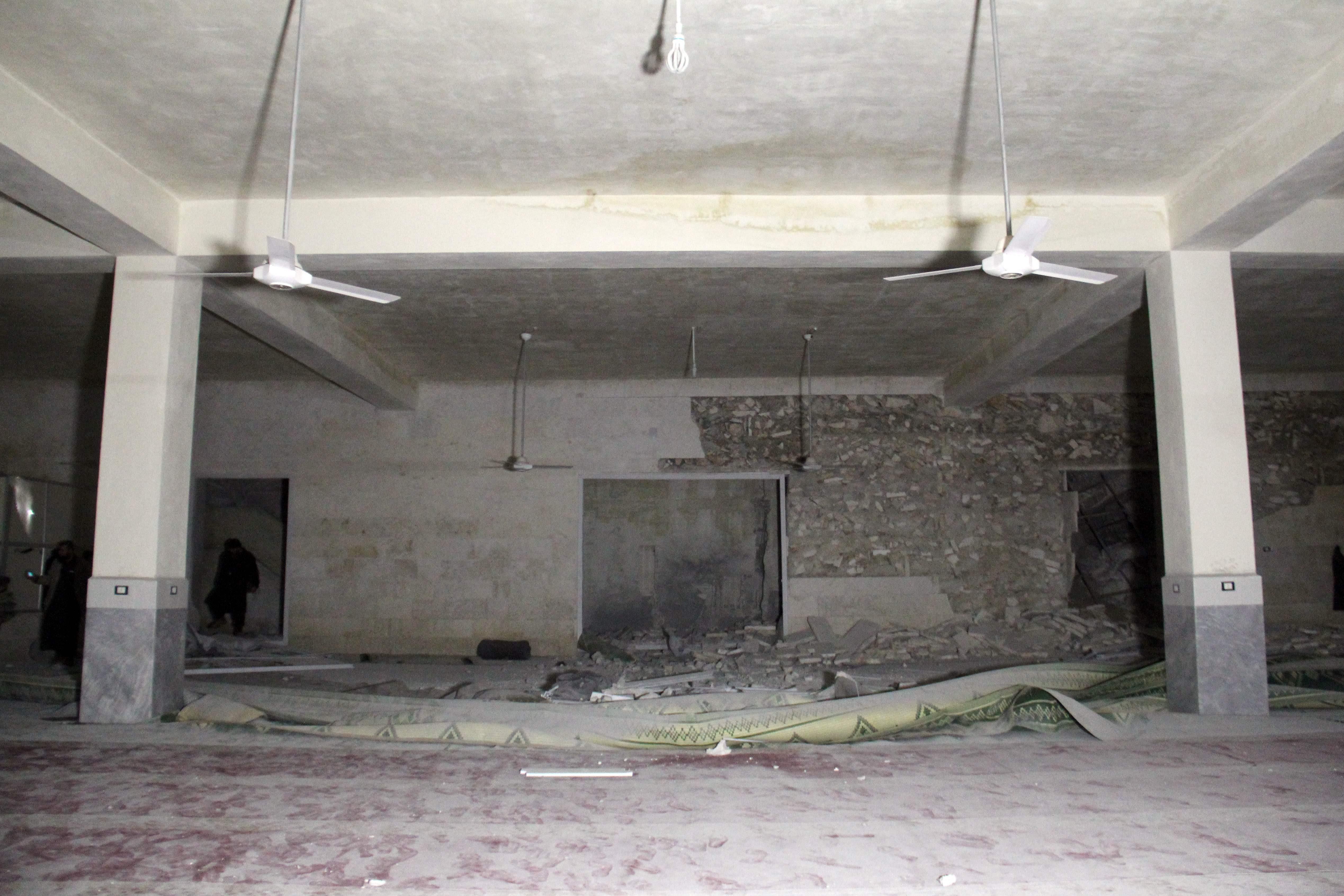 Damaged building, apparently a Muslim prayer hall, at site of al-Jineh air strike
