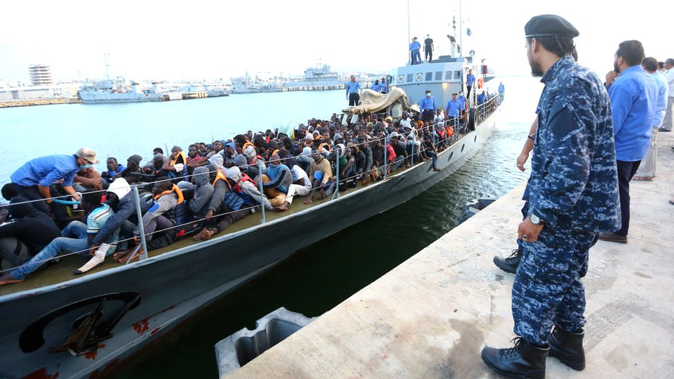 Migrants rescued by the Libyan coastguard in the Mediterranean off the Libyan coast arrive at a naval base in the capital, Tripoli, on 26 May 2017