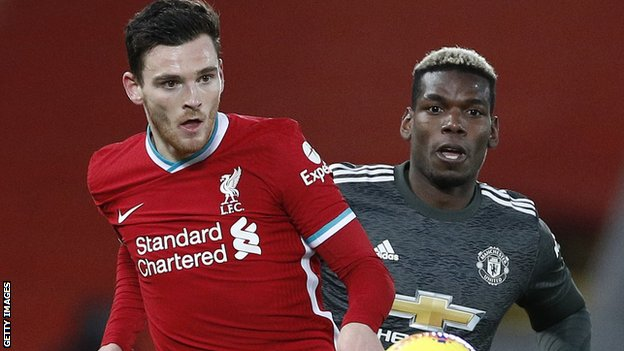 Andy Robertson y Paul Pogba