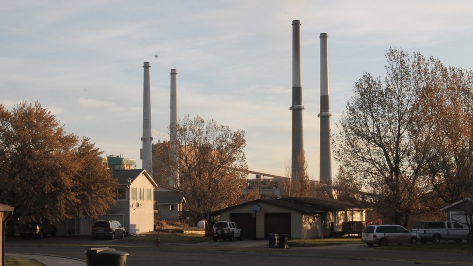 Four smokestacks from the local power plant over Colstrip, Montana