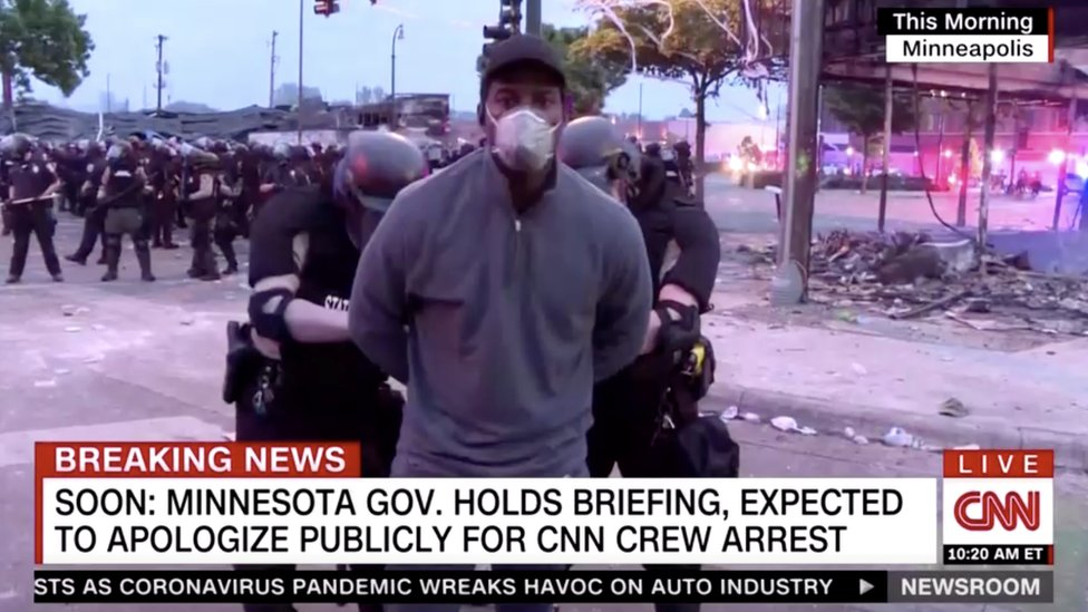Members of a CNN crew are arrested at a protest