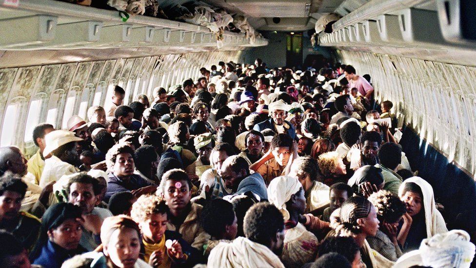 Ethiopian Jews sit on board an Israeli air force plane flying them from Addis Ababa to Tel Aviv on 25 May 1991